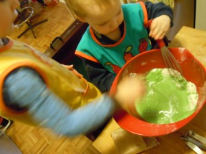 "After adding the warm water (& oil) to the dry ingredients.  Bl's reaction: ""Yuck!"" Didn't know he knew that word! Notice the distrusting look he is giving ""that green stuff""..."